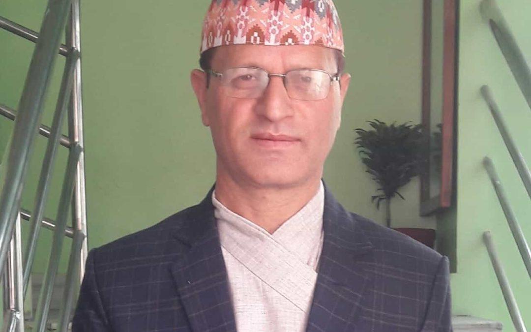 Dr ganesh raj adhikari wearing nepali cap