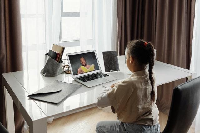 girl in front of laptop having online class