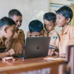 negative effects of gadgets children in front of laptop
