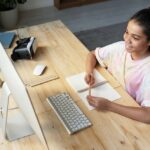 Benefits of online education girl in front of computer