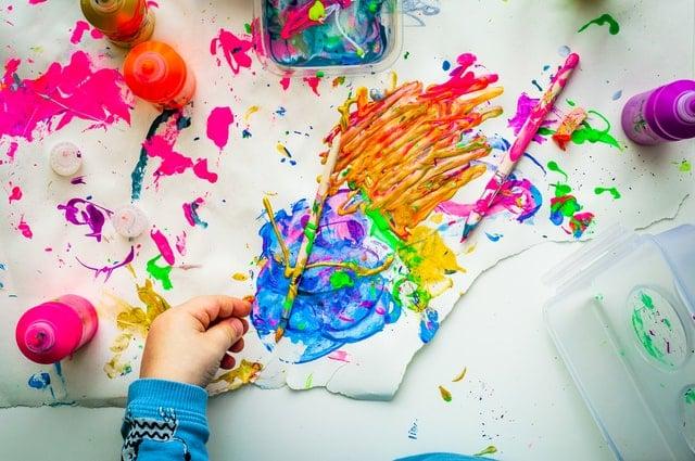 Kid's hand doing paintings